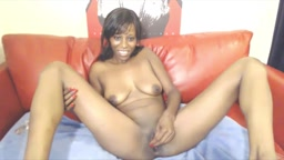 Alluring ebony with long tongue fucking her big toy