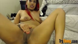 Hot black babe Phoenix with booty plays with long dildo